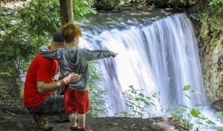 Father and son looking at waterfalls